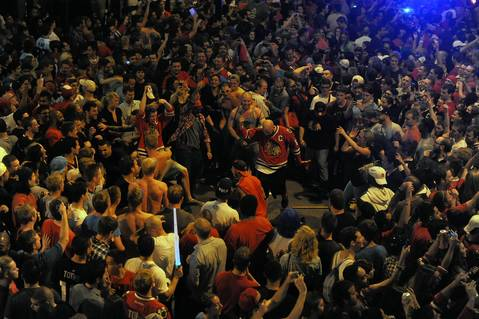 Fans on N. Clark Street celebrate the Chicago Blackhawks winning the Stanley Cup Final.