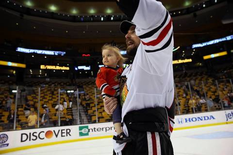 Patrick Sharp celebrates with his daughter Madelyn.