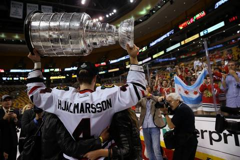 Blackhawks defenseman Niklas Hjalmarsson poses with the Stanley Cup.