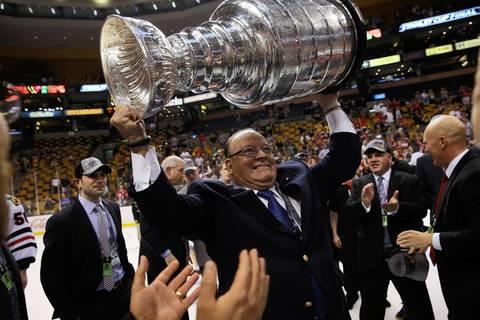 Blackhawks senior advisor Scotty Bowman celebrates with the Stanley Cup.
