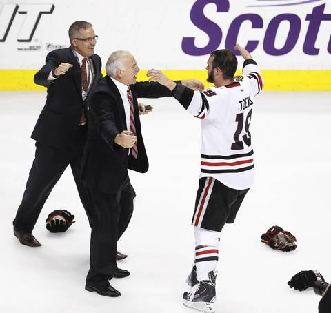 Jonathan Toews goes over to hug coach Joel Quenneville.
