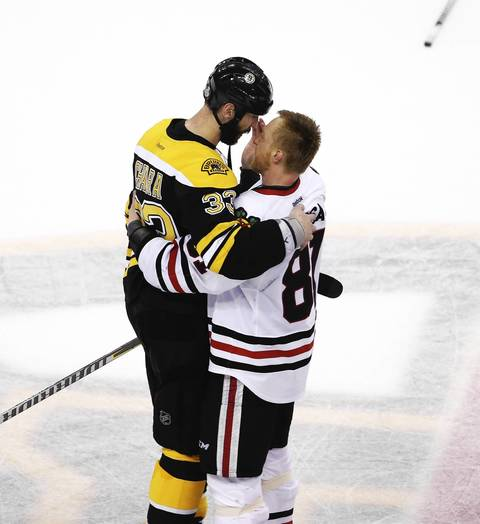 Marian Hossa hugs the Bruins' Zdeno Chara at the end of their game.