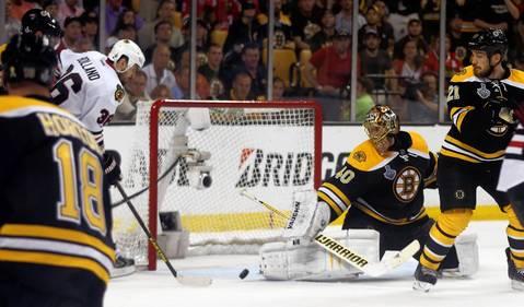 Dave Bolland readies to score the game-winning goal against Bruins goalie Tuukka Rask in the third period.