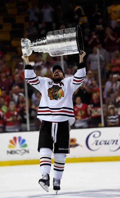 Patrick Sharp lifts the Stanley Cup.