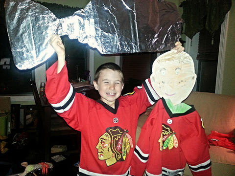 My son with his Flat Stanley and the Flat Stanley Cup that my daughter made.