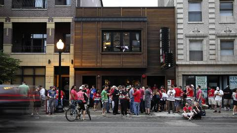 Blackhawks fans wait to enter the Pony Inn at 1638 W. Belmont Ave. in Chicago to celebrate the Stanley Cup Championship.