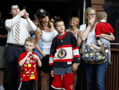 Several hundred fans wait outside the York Tavern in Oak Brook on Tuesday for Blackhawks coach Joel Quenneville to show up. The coach lives nearby in Hinsdale and frequents the York.