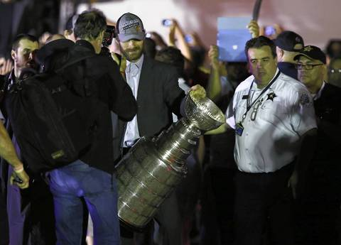 Michal Handzus carries the Stanley Cup after arriving at O'Hare International Airport at about 4:20 a.m. Tuesday.