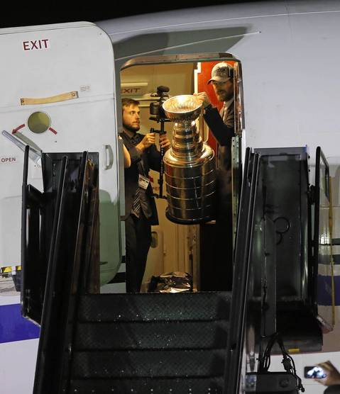 Michal Handzus exits with the Stanley Cup after arriving at O'Hare International Airport.