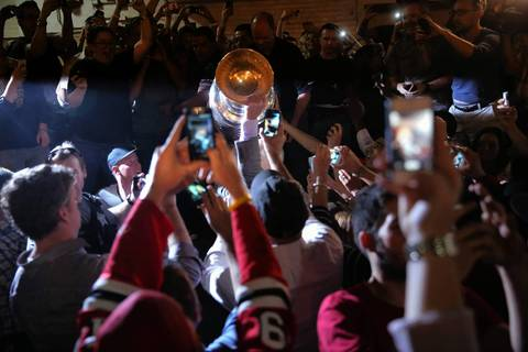Fans surround the Stanley Cup on the loading dock of Tribune Tower as the cup is taken on tour of Chicago.