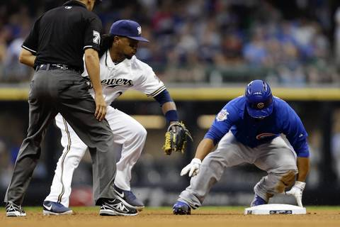 Wellington Castillo beats the tag from Rickie Weeks.