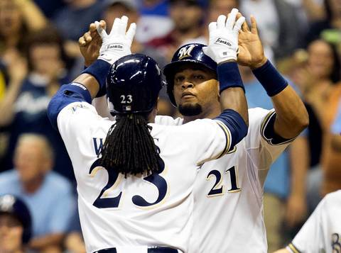 Brewers second baseman Rickie Weeks is greeted by first baseman Juan Francisco after hitting a home run during the sixth inning.