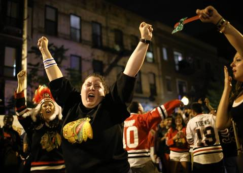Fans celebrate the Blackhawks Stanley Cup victory on Madison Street, in downtown Chicago.