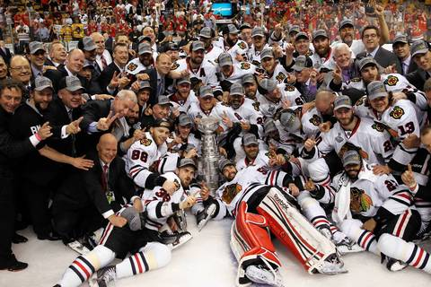 The Blackhawks pose with the Stanley Cup.