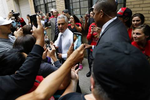 Mayor Rahm Emanuel leaves The Scout bar in Chicago after congratulating the Blackhawks on winning the Stanley Cup.