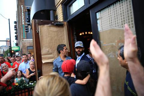 Blackhawks fans gather around defenseman Johnny Oduya at The Scout bar at East 13th Street and South Wabash Avenue.