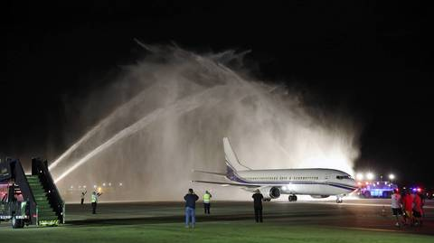 A Chicago Fire Department water cannon salute sprays the chartered plane carrying the Blackhawks to O'Hare International Airport.