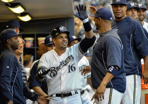 The Brewers' Aramis Ramirez is greeted in the dugout after hitting a solo home run in the 2nd inning.