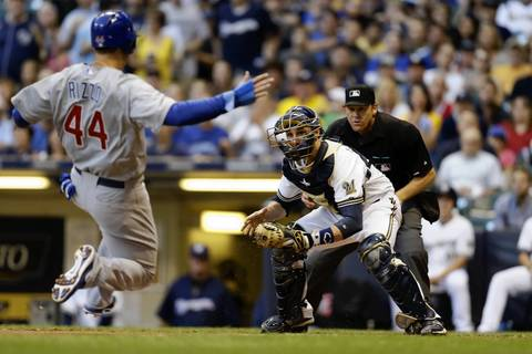 Brewers catcher Jonathan Lucroy tags out Anthony Rizzo as he slides into home plate in the top of the first inning.