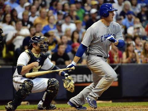 Anthony Rizzo drives in two runs with a single in the 4th inning against the Brewers. at Miller Park. At left is Milwaukee Brewers catcher Jonathan Lucroy. Mandatory Credit: Benny Sieu-USA TODAY Sports ORG XMIT: USATSI-122668