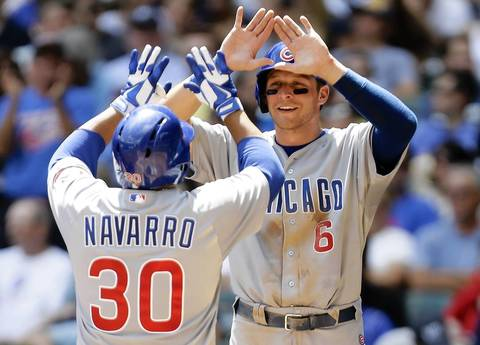 Dioner Navarro celebrates with Ryan Sweeney after hitting a three-run home run in the third.