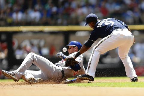 Jean Segura loses the ball, allowing Ryan Sweeney a stolen base in the second inning.