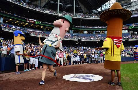 he 20th anniversary of the racing sausages was marked with a ceremony before game.