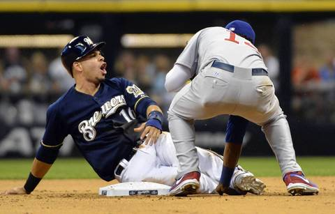 Brewers third baseman Aramis Ramirez reacts after he was called out trying to steal second base in the sixth as Starlin Castro applied the tag