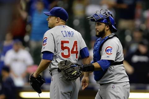 Shawn Camp (left) and Dioner Navarro celebrate after the Cubs' 7-2 win.