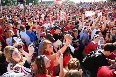 Fans wait at Congress Parkway and Michigan Avenue for entrance to the Blackhawks rally in Chicago.