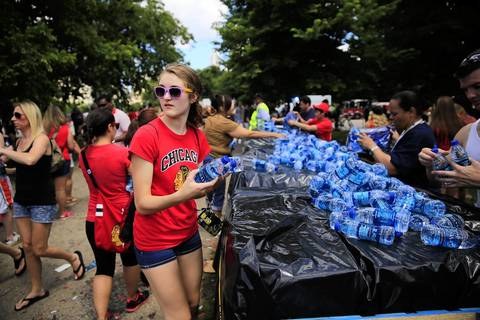 Fans grab free water at Hutchinson Field.