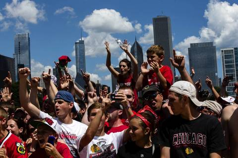 Fans celebrate the Blackhawks during the rally in Grant Park.