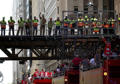 CTA workers get a bird's eye view of the parade as it passes through the Loop.