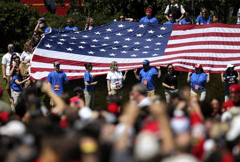 A large U.S. flag is unfurled in Chicago's Grant Park for the celebration of the Stanley Cup champion Chicago Blackhawks.