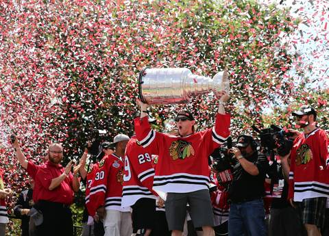 Chicago Blackhawks right wing Patrick Kane (88) celebrates onstage at the rally.