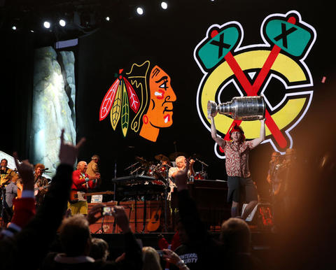 Jimmy Buffett stands by as Patrick Kane shows off the Stanley Cup during a Buffett concert at FirstMerit Bank Pavilion at Northerly Island.