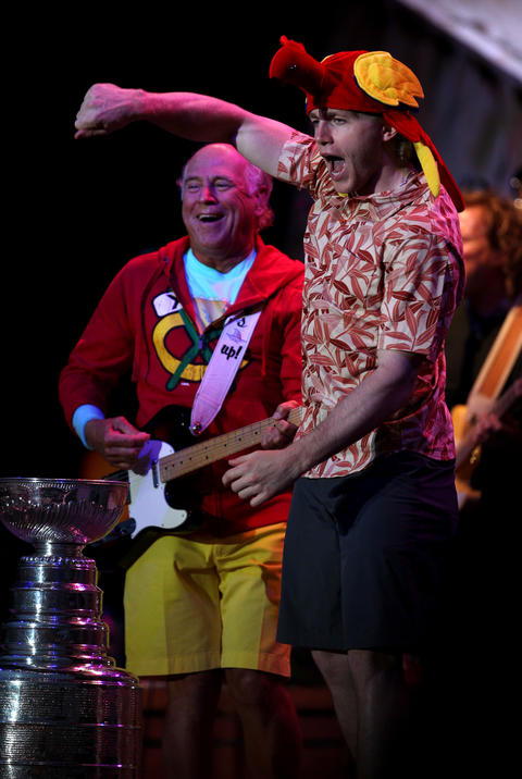 Patrick Kane pumps his fist while showing off the Stanley Cup during a Jimmy Buffett concert at FirstMerit Bank Pavilion at Northerly Island.
