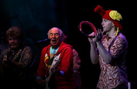 Patrick Kane plays the tambourine beside Jimmy Buffett.