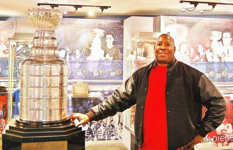 I am at the Hockey Hall of Fame in Toronto and I am touching the Stanley Cup where the names of the 2010 Chicago Blackhawks Champions names are located!!