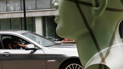 A passer-by takes a picture from his car of the head planter.