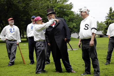 """Arbiter Ray """"Never Wrong"""" Grish, center, handles a light-hearted coin toss dispute between Bob """"Zeus"""" Rzeszutko of the Salmon Base Ball Club of Chicago, right, and Bob Tholkes of the Union Base Ball Club of Minnesota."""