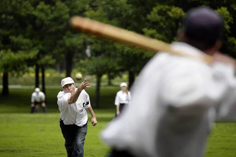 """Paul """"Scooter"""" Zeledon """"hurls"""" for the Salmon Base Ball Club of Chicago. The role of the hurler is to throw the ball with a sweeping underhanded motion to make it easy to hit."""