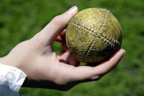 A vintage-style base ball called an onion is made from a single piece of leather.