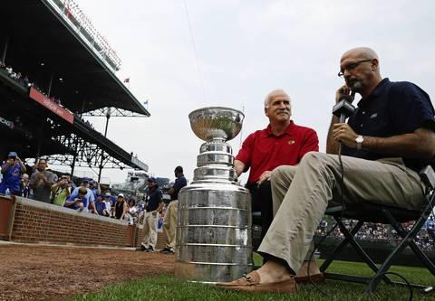 Blackhawks coach Joel Quenneville is interviewed by Cubs announcer Jim DeShaies at Wrigley Field.