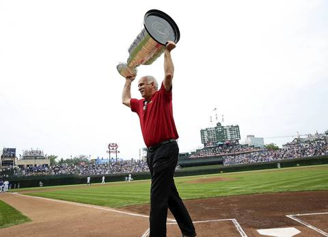 Blackhawks coach Joel Quenneville hoists the Stanley Cup at Wrigley Field.