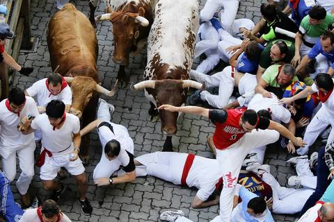 Running of the bulls Several thousand thrill-seekers ran alongside fighting bulls through the streets of the Spanish city of Pamplona on the first day of the running of the bulls.