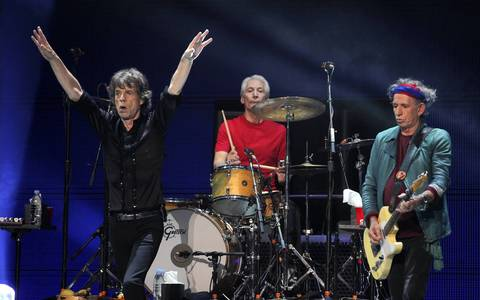 Mick Jagger, left, Charlie Watts, center, and Keith Richards perform at the United Center in Chicago.