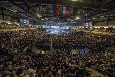 Thousands of people wait for the start of a memorial service for the fallen members of the Granite Mountain Hotshots in Prescott Valley, Arizona.