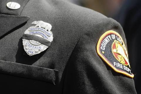 Members of fire departments from around the country attend a memorial in honor of the 19 firefighters killed in the Yarnell Hill Fire at Tim's Toyota Center in Prescott Valley, Arizona.