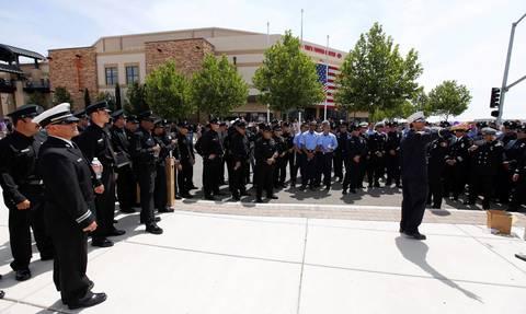 Los Angeles firefighters gather outside the memorial.
